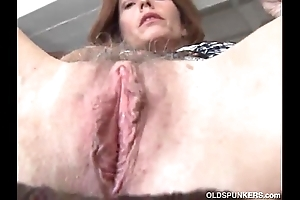 Grown up redhead copulates the brush love tunnel together with chocolate hole