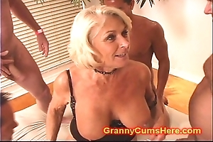 Granny acquires a strip burgeoning increased by cum depollute