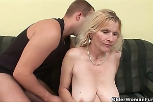 Elder mom alongside obese tits together with muted snatch receives facial