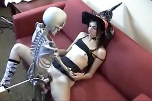 Who is she? witch bonking skeleton